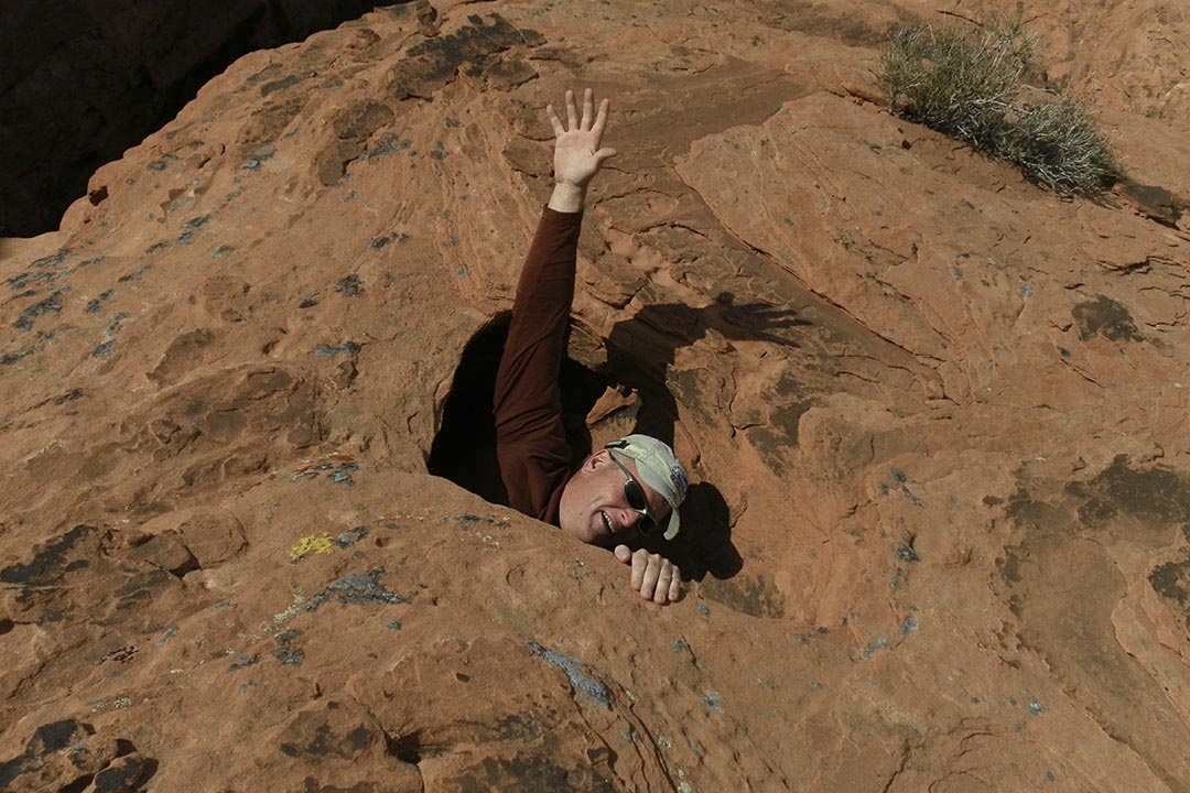 Hiker swallowed up by sandstone manhole, Valley of Fire State Park, Nevada by Steve Bruno