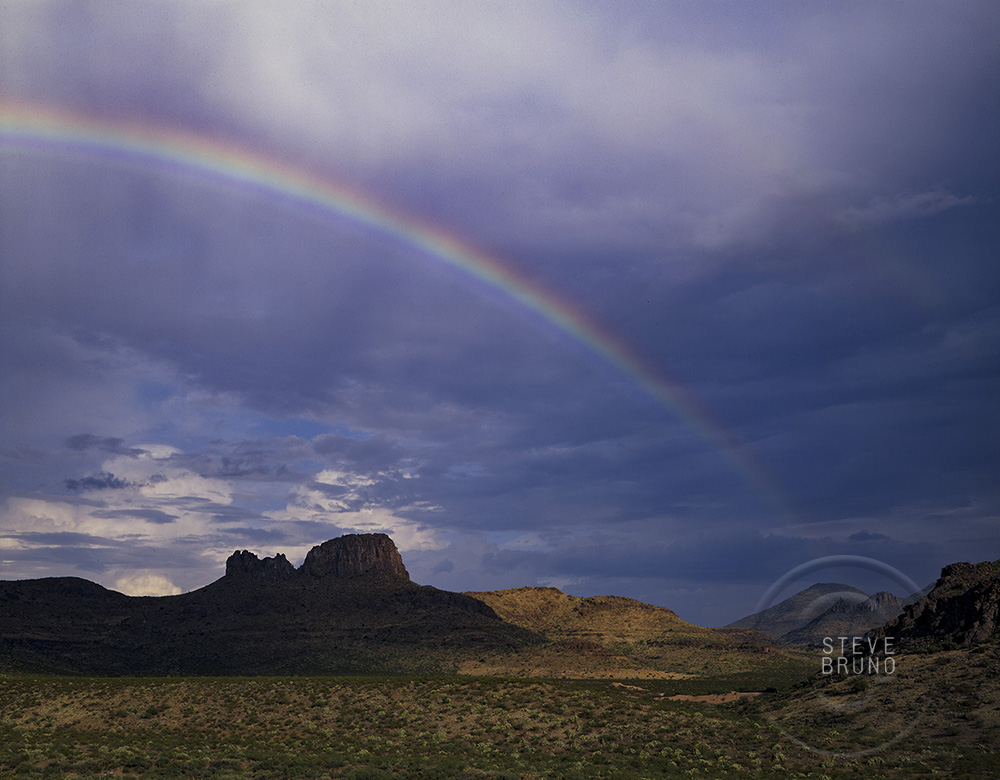Rainbow in the desert of southern Arizona by Steve Bruno